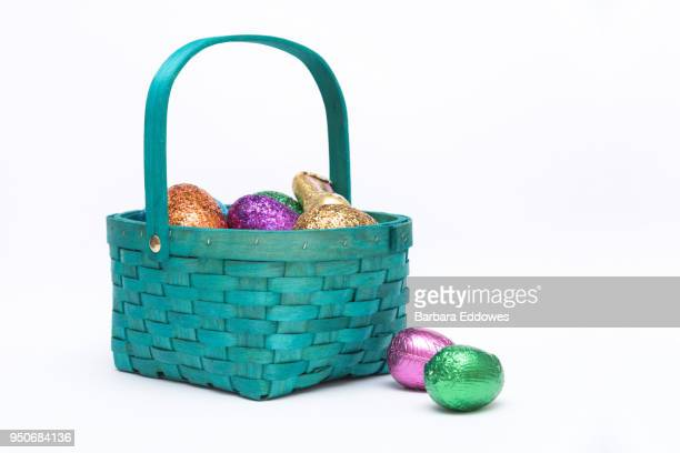 easter egg basket - easter egg stock pictures, royalty-free photos & images