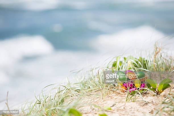 easter egg beach basket - easter beach stock pictures, royalty-free photos & images