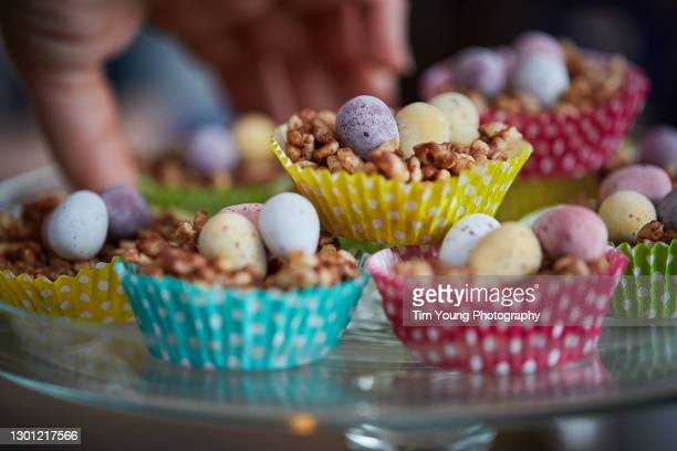 easter egg cakes in colourful cake cases - easter cake stock pictures, royalty-free photos & images