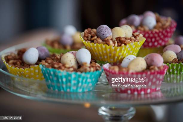 easter egg cakes in colourful cake cases - easter egg stock pictures, royalty-free photos & images