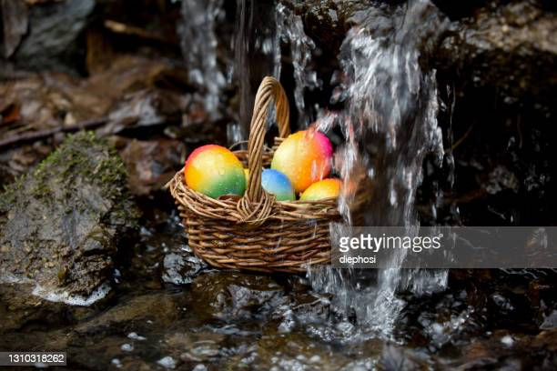 easter egg hunt falls into the water - easter sunday stock pictures, royalty-free photos & images