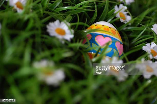 Easter egg lying between gras