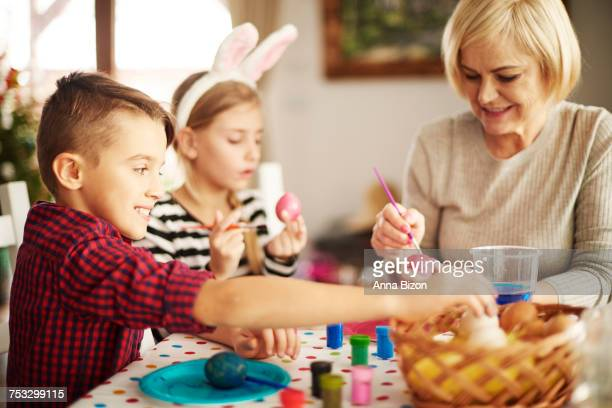 easter egg painting and decorating. krakow, poland  - plastic plate stock photos and pictures