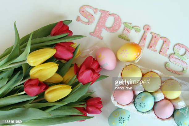 Easter Eggs And Tulips Over Pink Background. Spring Concept