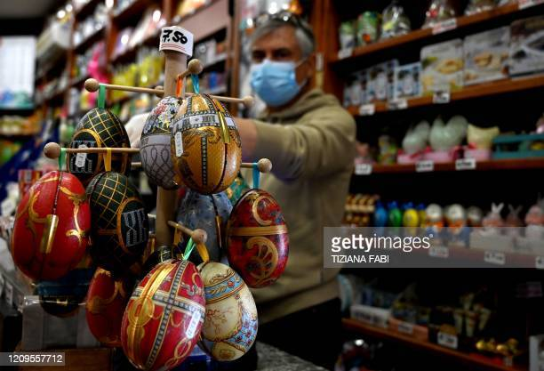 Easter eggs are displayed at a delicatessen food store in Rome on April 9 2020 during the country's lockdown aimed at curbing the spread of the...