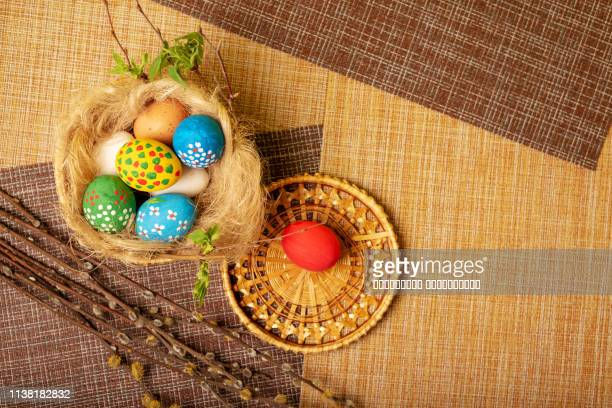 easter eggs are in the basket. painted in the colors of the rainbow. nest of straw. - easter religious background stock pictures, royalty-free photos & images