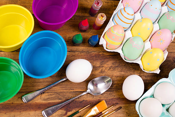 Easter Eggs Being Decorated On Wooden Table. Decorating Supplies. Wall Art