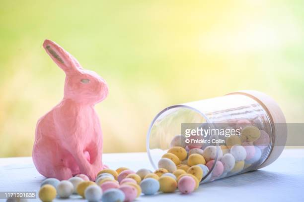 easter eggs fallen from a glass jar and tulips bouquet - easter flowers stock pictures, royalty-free photos & images