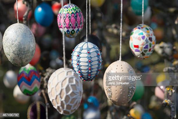 Easter eggs hang on an apple tree decorated with approximately 10000 Easter eggs on the property of pensioner Volker Kraft on March 25 2015 in...