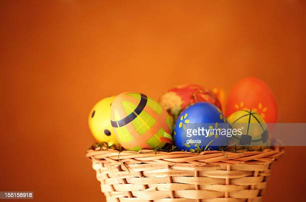easter eggs in a basket. - easter basket stock pictures, royalty-free photos & images