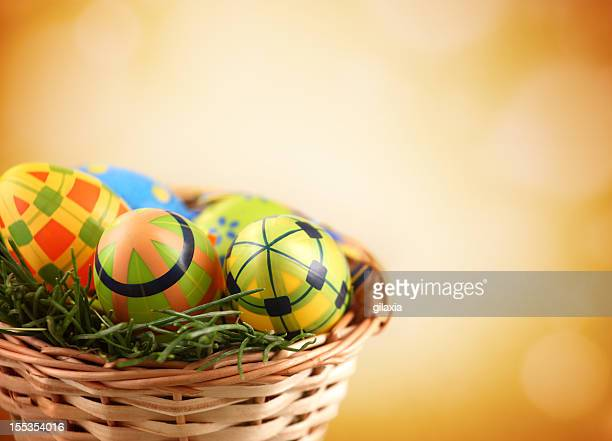 easter eggs in a basket. - easter religious background stock pictures, royalty-free photos & images