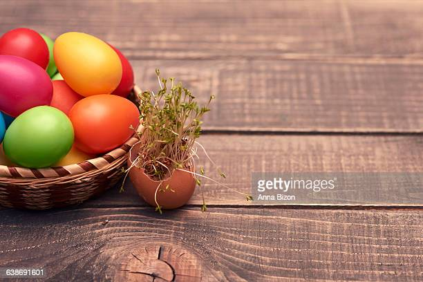 Easter eggs in a pretty basket lying on a wooden table. Debica, Poland