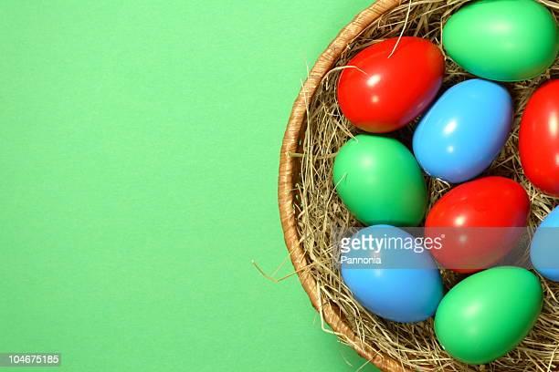 easter eggs in basket - osternest stock-fotos und bilder