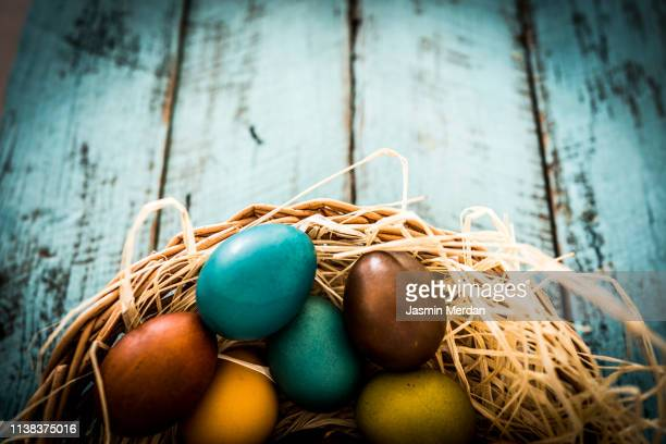 easter eggs in basket - easter religious background stock pictures, royalty-free photos & images