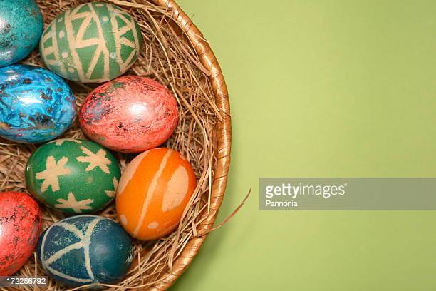 Easter Eggs in Nest on Green