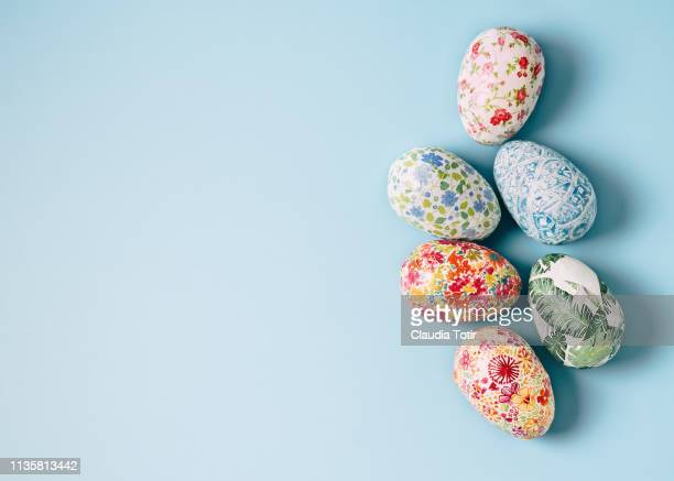 easter eggs on blue background - easter stock pictures, royalty-free photos & images