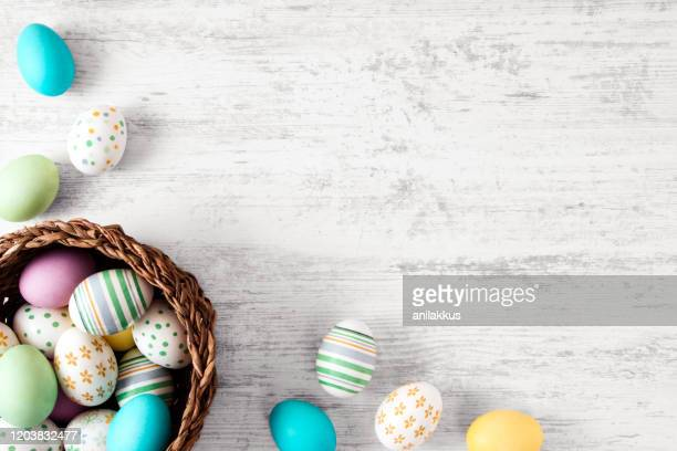 easter eggs on old white wood background - easter egg stock pictures, royalty-free photos & images
