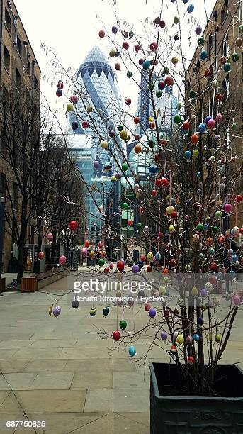 Easter Eggs On Tree With The Gherkin In Background In London