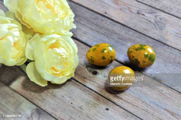 easter eggs on wooden background - easter religious background stock pictures, royalty-free photos & images