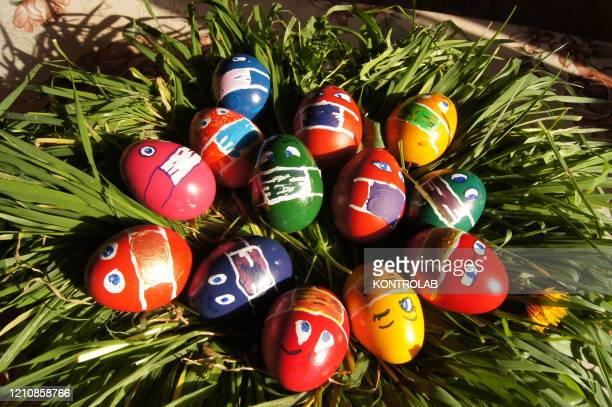 Easter eggs painted with face masks, a different take on an Orthodox Christian tradition in Romania. This year, due to the Coronavirus pandemic also...