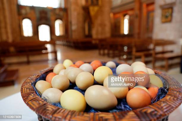 Easter eggs sit in a basket during a crowdless Easter Mass service due to the COVID-19 pandemic, at the Saint George Greek Orthodox Church in the...