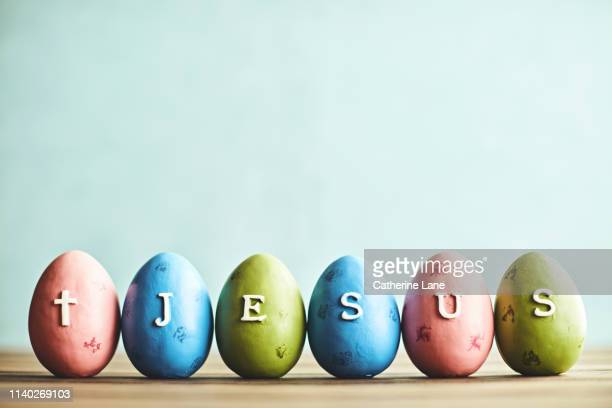 easter eggs spelling the word jesus - happy easter jesus stock pictures, royalty-free photos & images