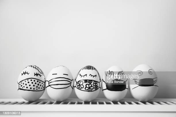 easter eggs wearing mask for easter holidays decoration. - variation stock pictures, royalty-free photos & images