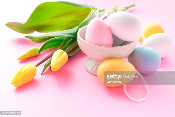 Easter eggs with yellow tulips
