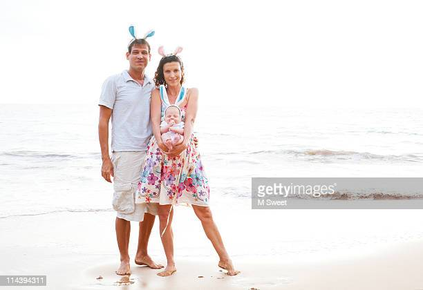 easter family on beach - easter beach stock pictures, royalty-free photos & images