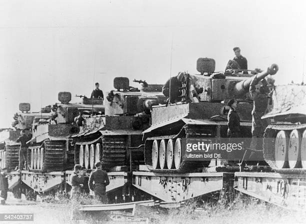 2WW easter front ' 'Tiger I' tanks being brought on railroadlowloaders into their provision depositories Kursk area June/Juli 1943