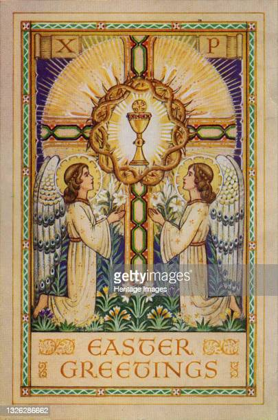 Easter Greetings, 1930s. Angels kneeling before a glowing Holy Grail within a crucifix. Artist Unknown.