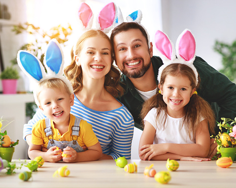 Easter. happy family mother father and children are preparing for holiday home with eggs 1131823081
