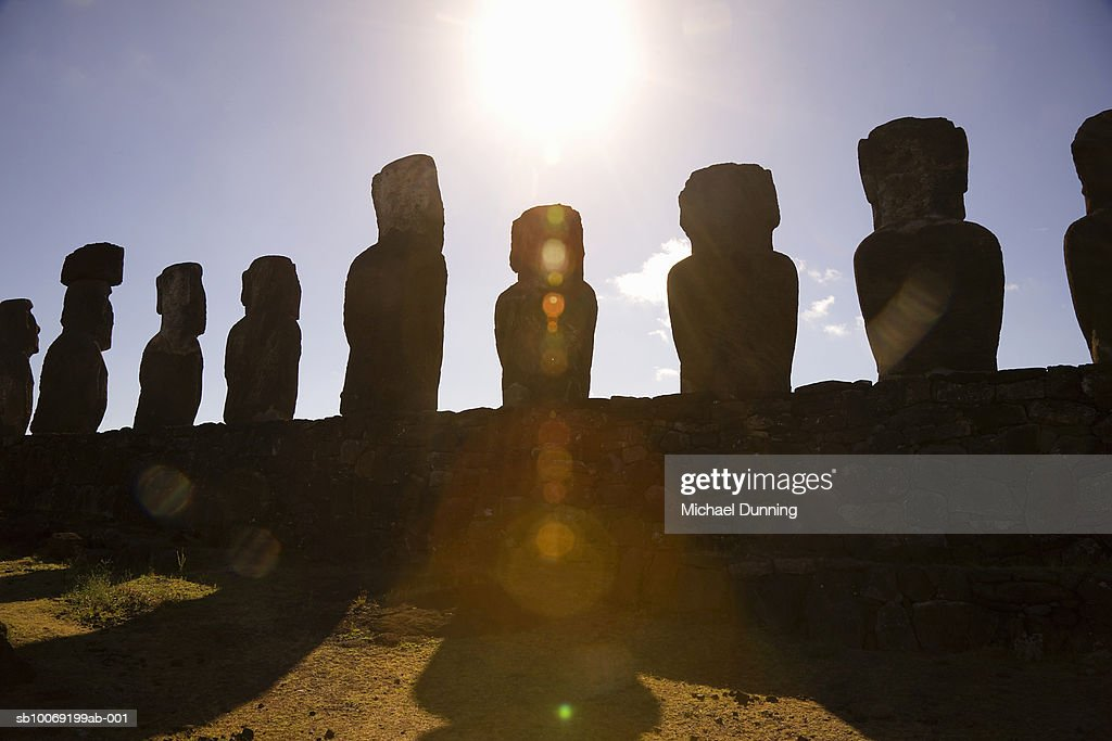 Easter Island, Ahu Tongafiki, row of ancient Moai statues at sunset : Stockfoto