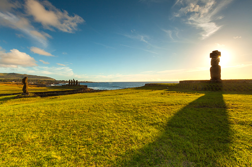 Easter Island - Beautiful single standing Moai Statue at Ahu Tahai with afternoon sky. - gettyimageskorea