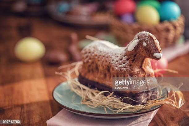 easter lamb cake served on a plate - pasqua foto e immagini stock