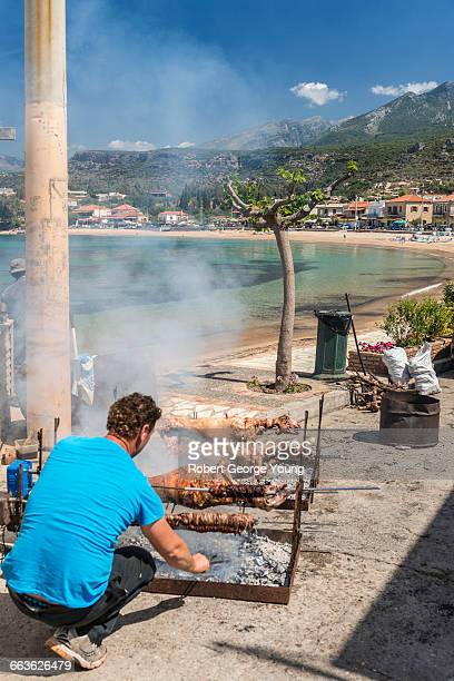 easter lamb roast, beach of stoupa greece - greek easter stock pictures, royalty-free photos & images