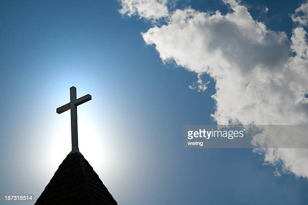 easter morning with the sun behind a church steepl cross. - church stock pictures, royalty-free photos & images