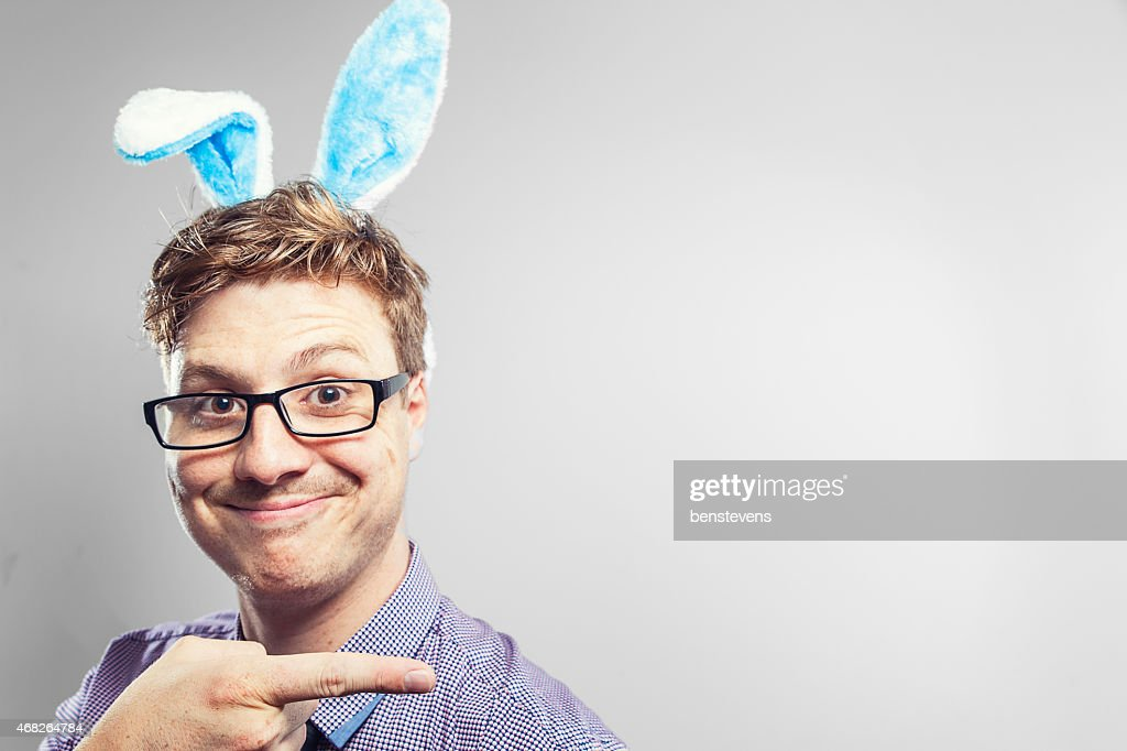 Easter nerd with rabbit ears in a photography studio : Stock Photo