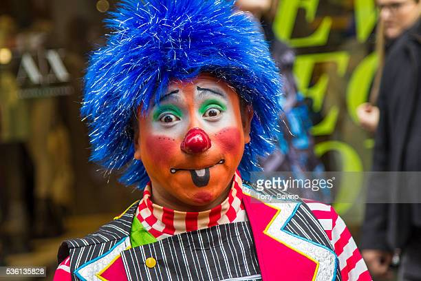 Easter Parade New York City Man dressed as clown Annual Easter Parade on 5th Ave NYC Photo Tony Savino