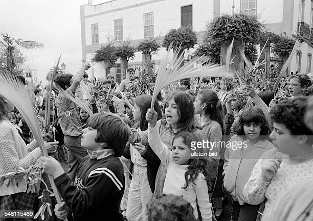 Easter Passion Week Palm Sunday 1981 church parade children wave palm branches aged 4 to 12 years Spain Canary Islands Canaries Tenerife La Orotava