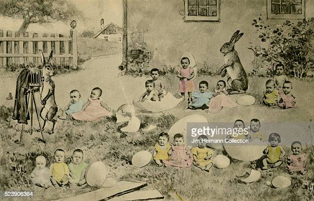 Easter postcard featuring anthropomorphic rabbit taking photograph of infant children hatching from eggs