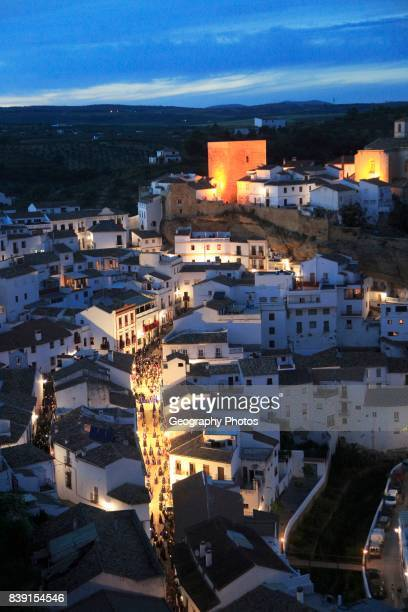 Easter procession at night through streets of Setenil de las Bodegas, Cadiz province, Spain.