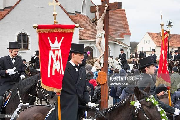 Easter riders sing as they parade on horseback on April 08 2012 in Ralbitz near Bautzen Germany Sorbians a Slavic minority in eastern Germany...