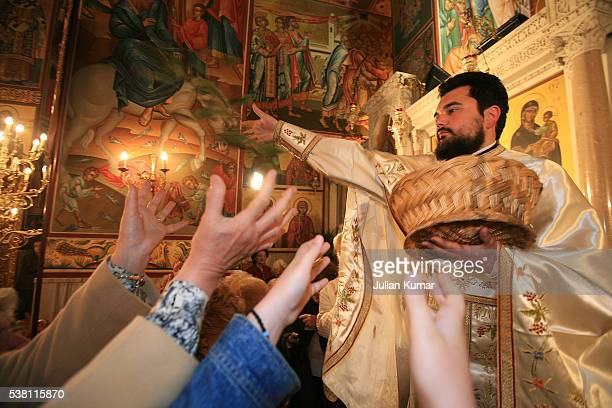 easter saturday leaf throwing ritual in a greek orthodox church - greek easter stock pictures, royalty-free photos & images