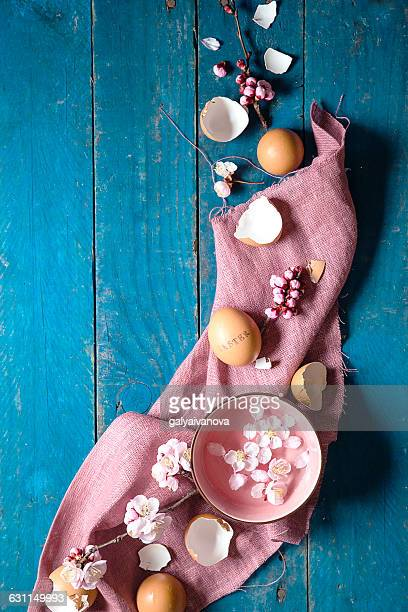Easter spring decoration with flowers, petals and eggshells