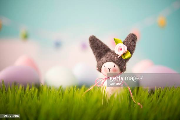Easter still life with handmade bunny in grass