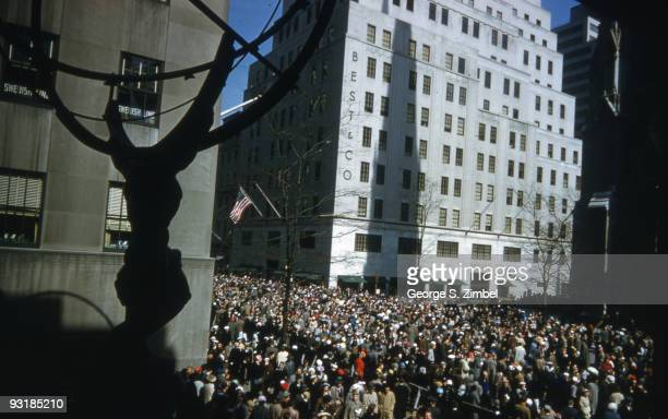 Easter Sunday view from the front of the International Building in Rockefeller Center, and of the statue of Prometheus across pedestrian traffic at...