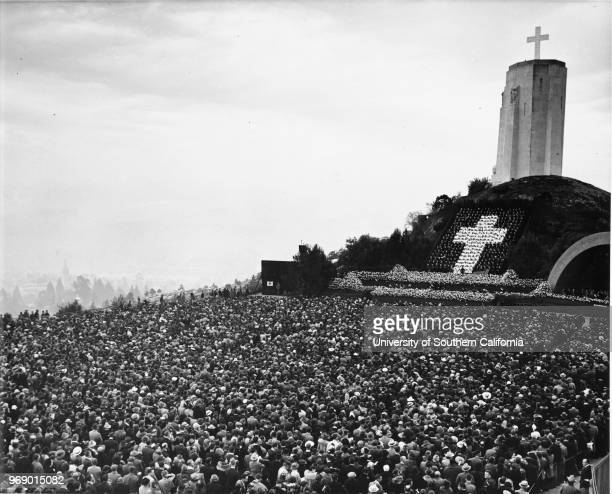 Easter Sunrise Services at the Forest Lawn Memorial Park with a crowd of thousands facing a huge cross Glendale California early to mid twentieth...