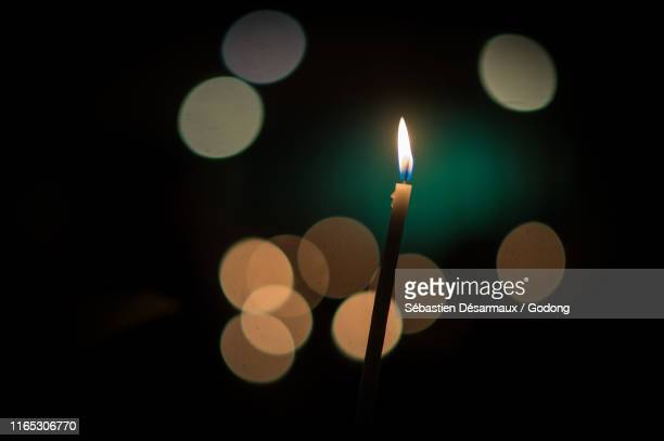 easter vigil in a catholic church, paris, france. - holy easter vigil stock pictures, royalty-free photos & images