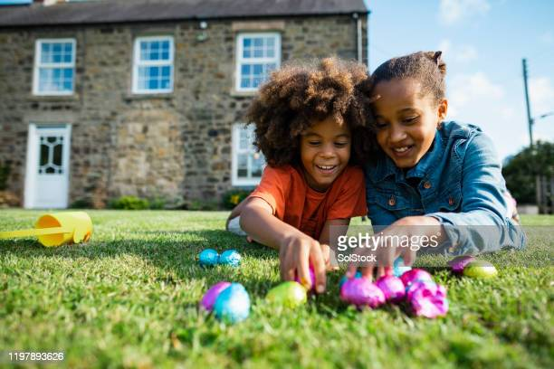 easter with my brother! - easter egg hunt stock pictures, royalty-free photos & images